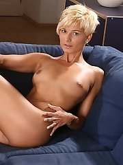 Katrin spreads 'em for you on the couch