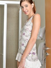 Nubile hottie strips naked and gets naughty in the shower